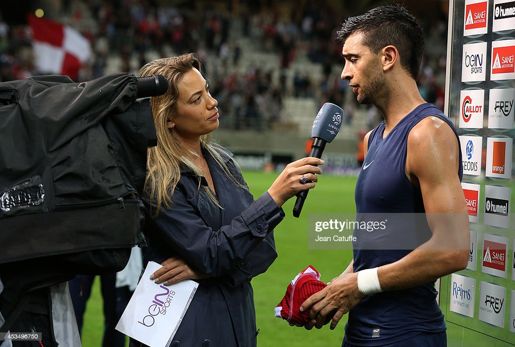 Anne-Laure Bonnet of beIN Sports interviews <a gi-track='captionPersonalityLinkClicked' href=/galleries/search?phrase=Javier+Pastore&family=editorial&specificpeople=5857872 ng-click='$event.stopPropagation()'>Javier Pastore</a> of PSG after the French Ligue 1 match between Stade de Reims and Paris Saint Germain FC at the Stade Auguste Delaune on August 8, 2014 in Reims, France.