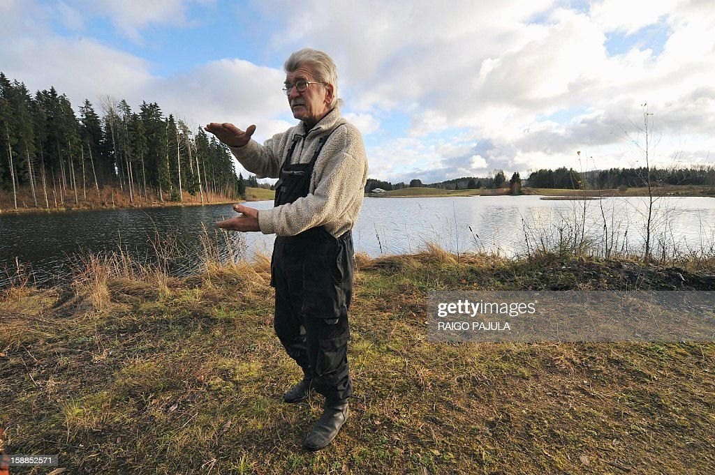Anneli REIGAS Estonian farmer Tonu Tamm, 71, is pictured on December 15, 2012 in Leigo. Estonian Tonu Tamm has dedicated the past two decades of his life to his obsession of creating artificial lakes. AFP PHOTO / Raigo Pajula
