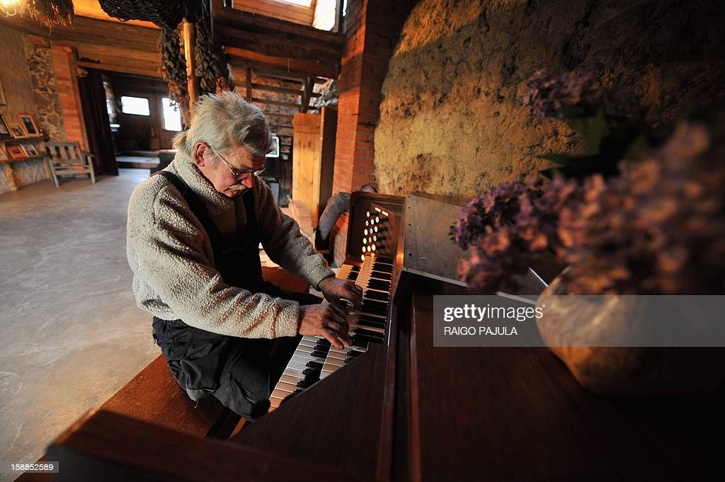 Anneli REIGAS Estonian farmer Tonu Tamm, 71, who created 14 artificial lakes plays an organ on December 15, 2012 in Leigo. Estonian Tonu Tamm has dedicated the past two decades of his life to his obsession of creating artificial lakes. AFP PHOTO / Raigo Pajula