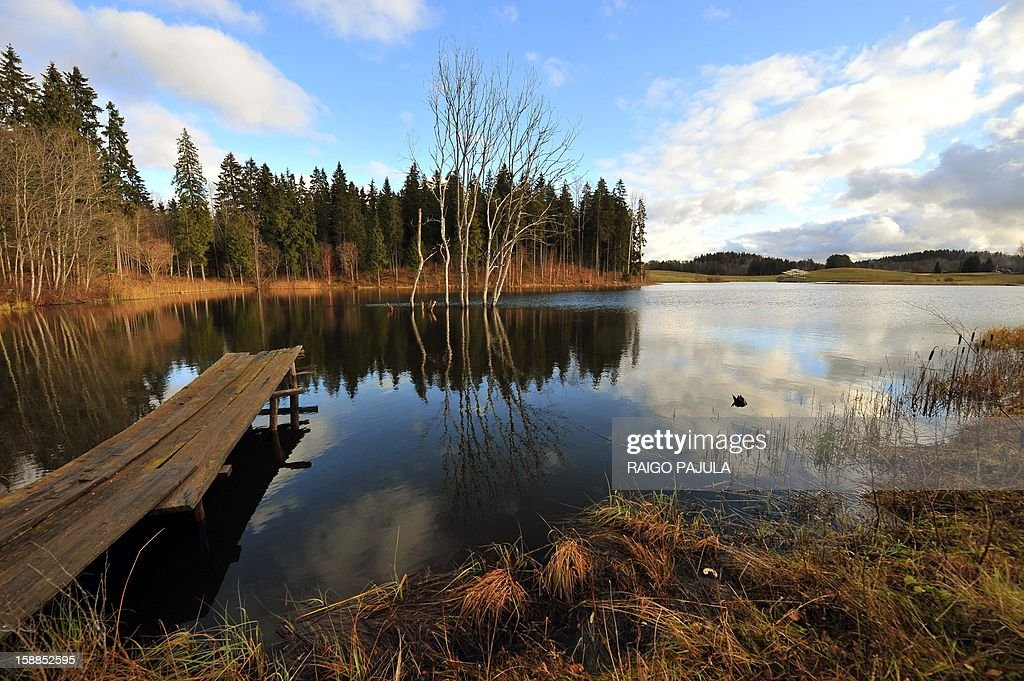 Anneli REIGAS This picture taken on December 15, 2012 shows an artificial lake created by Estonian farmer Tonu Tamm in Leigo. Estonian Tonu Tamm has dedicated the past two decades of his life to his obsession of creating artificial lakes. AFP PHOTO / Raigo Pajula