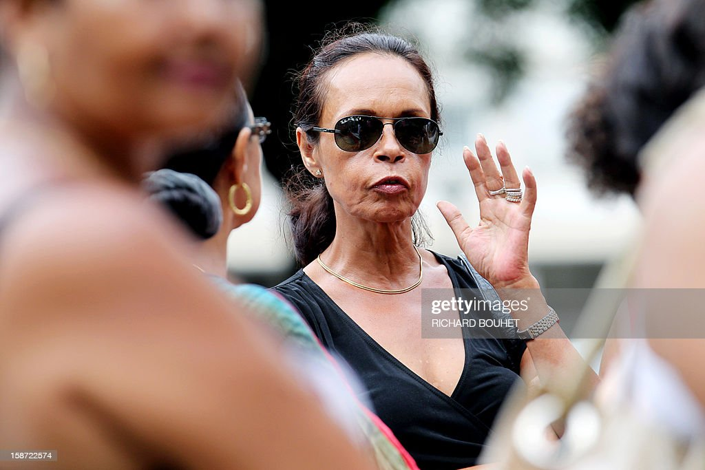 Anne-Marie Collomp, wife of kidnapped French engineer Francis Collomp, leaves after a meeting with local authorities on December 26, 2012 in Saint-Denis de la Reunion, on the French Indian Ocean island of Reunion. The radical Islamist group Ansaru claimed the recent kidnapping in northern Nigeria of Collomp, citing France's push for a military intervention in Mali as a justification. Ansaru, 'announces to the world, especially the French government, that it was responsible for the abduction of engineer Francis Collomp, 63, working for the French company Vergnet,' a statement emailed to journalists said.
