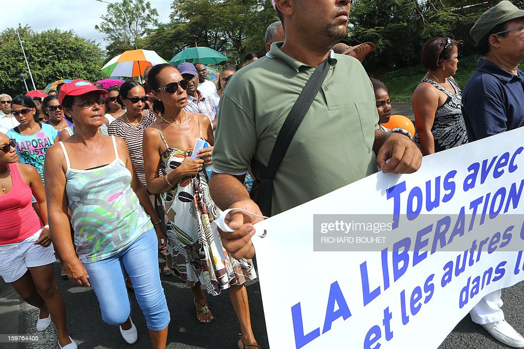 Anne-Marie Collomp (2L), wife of kidnapped French engineer Francis Collomp, walks with supporters in Le Port, on the French Indian Ocean island of Reunion, on January 20, 2013 during a march demanding the release of her husband. The radical Islamist group Ansaru claimed the recent kidnapping in northern Nigeria of Collomp, citing France's push for a military intervention in Mali as a justification. Ansaru, 'announces to the world, especially the French government, that it was responsible for the abduction of engineer Francis Collomp, 63, working for the French company Vergnet,' a statement emailed to journalists said.