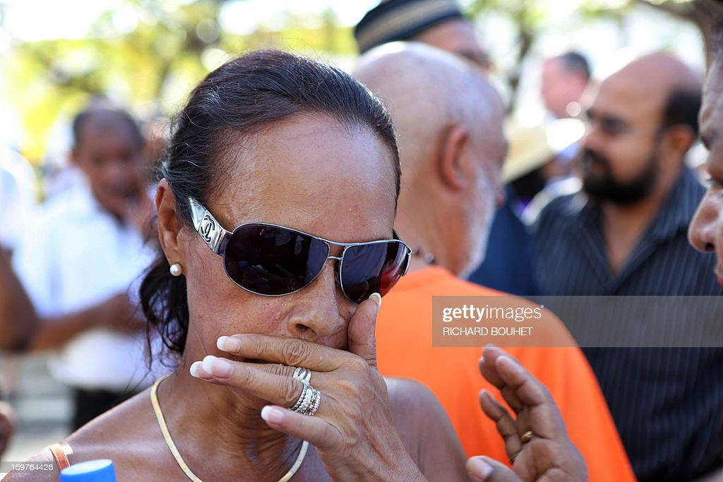 Anne-Marie Collomp, wife of kidnapped French engineer Francis Collomp, walks with supporters in Le Port, on the French Indian Ocean island of Reunion, on January 20, 2013 during a march demanding t...