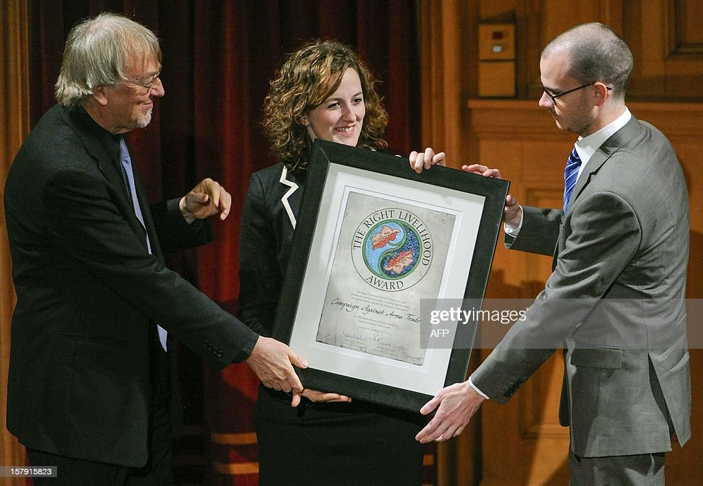 Anne-Marie O'Reilly (C) and Henry McLaughlin (R), of the Campaign Against Arms Trade receive the Right Livelihood Prize from the founder Jacob von Uexkull (L) during a ceremony at the Swedish Parliament in Stockholm on December 7, 2012.