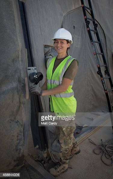 SAC AnneMarie Sayle from RAF Wittering's 5001 Squadron poses for a photograph as she helps take down a hanger that houses RAF Tornado jets at...