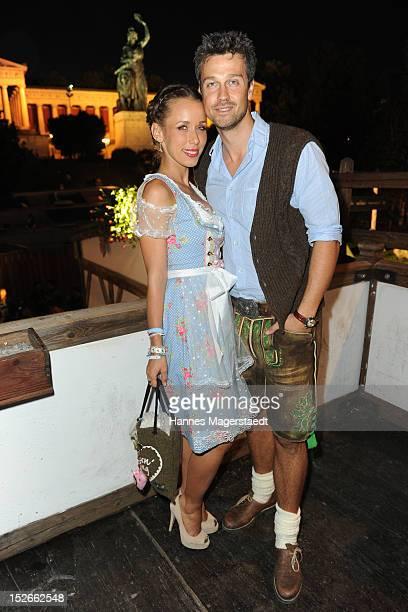 Annemarie Warnkross and Wayne Carpendale attend the Oktoberfest beer festival at Kaefer on September 23 2012 in Munich Germany