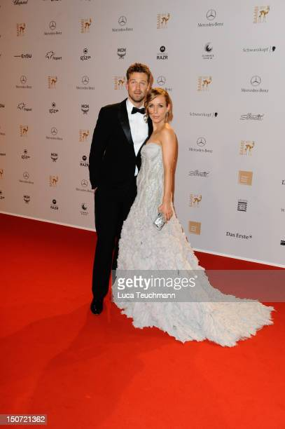 Annemarie Warnkross and Wayne Carpendale attend the Red Carpet for the Bambi Award 2011 ceremony at the RheinMainHallen on November 10 2011 in...