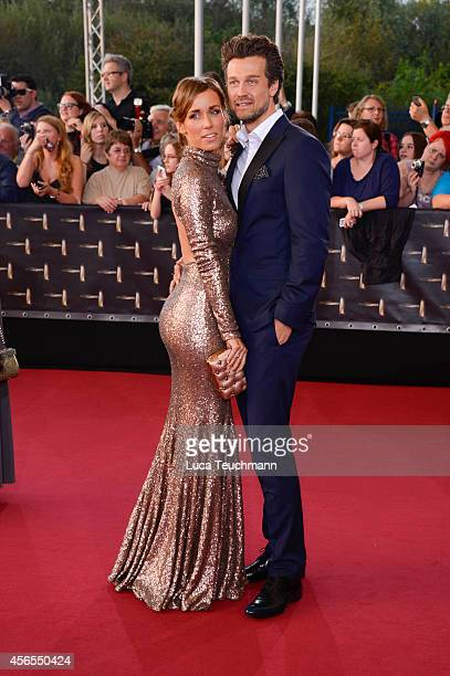 Annemarie Warnkross and Wayne Carpendale attend the red carpet of the Deutscher Fernsehpreis 2014 at Coloneum on October 2 2014 in Cologne Germany
