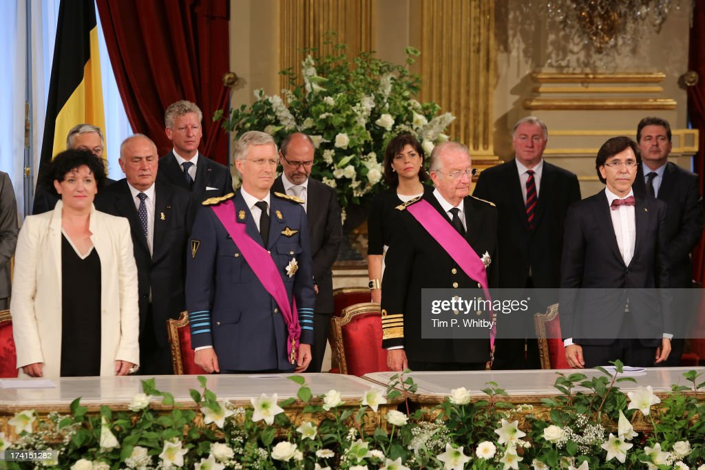 Annemie Turtelboom, Prince Philippe of Belgium, King Albert II of Belgium and Elio Di Rupo pose at the Abdication Ceremony Of King Albert II Of Belgium, & Inauguration Of King Philippe at the Royal Palace on July 21, 2013 in Brussels, Belgium.