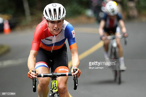 Annemiek van Vleuten of the Netherlands leads Mara Abbott of the United States during the Women's Road Race on Day 2 of the Rio 2016 Olympic Games at...