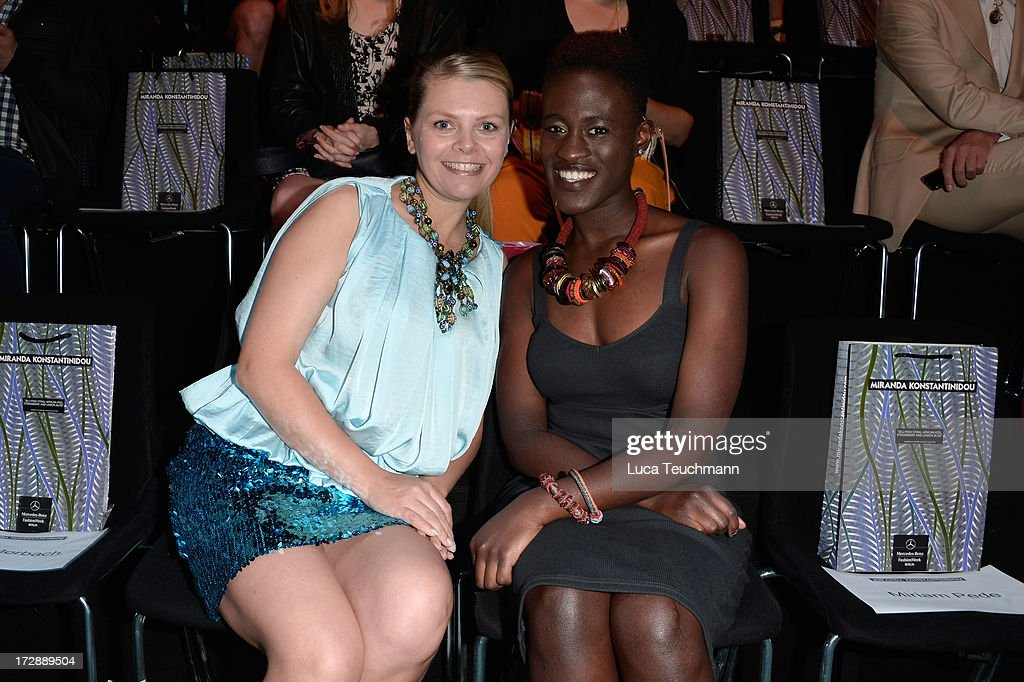Anne-Sophie Briest and Ivy Quainoo attend the Miranda Konstantinidou Arrivals at Brandenburg Gate on July 5, 2013 in Berlin, Germany.