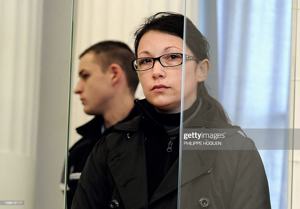 Anne-Sophie Faucheur waits at the Douai courthouse, northern France, on January 21, 2013 before the start of her trial in connection with her daughter's death. The body of her daughter Typhaine was found in December 9, 2009 in a suburb of the southern Belgian city of Charleroi and Faucheur and the stepfather of the child, Nicolas Willot, finally recognized that she had died at their house on June 10, 2009 and that her body had been buried somewhere in Belgium.