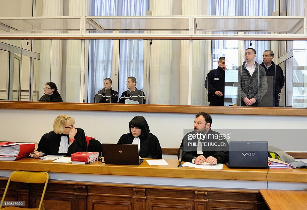 Anne-Sophie Faucheur (L), with her companion Nicolas Willot (R), waits at the Douai courthouse, northern France, on January 21, 2013 before the start of her trial in connection with her daughter's death. The body of her daughter Typhaine was found in December 9, 2009 in a suburb of the southern Belgian city of Charleroi and Faucheur and the stepfather of the child, Nicolas Willot, finally recognized that she had died at their house on June 10, 2009 and that her body had been buried somewhere in Belgium. AFP PHOTO PHILIPPE HUGUEN