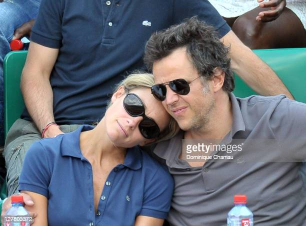 AnneSophie Lapix and her husband Arthur Sadoun attend the French open at Roland Garros on June 4 2011 in Paris France