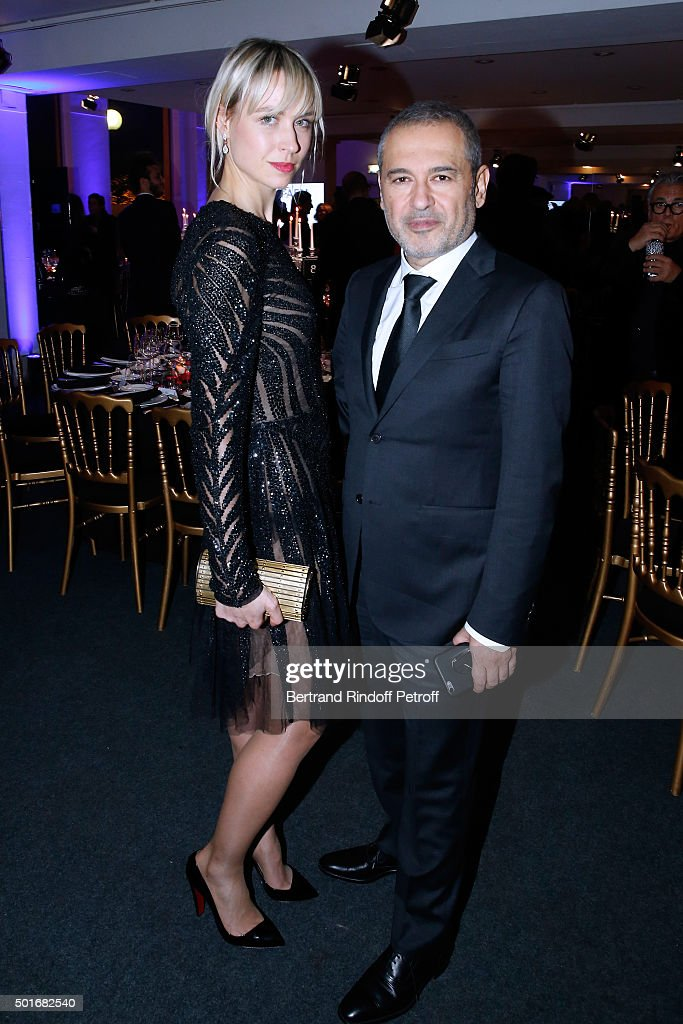 Anne-Sophie Mignaux and Fashion Designer Elie Saab attend the Annual Charity Dinner hosted by the AEM Association Children of the World for Rwanda. Held at Espace Cardin on December 16, 2015 in Paris, France.
