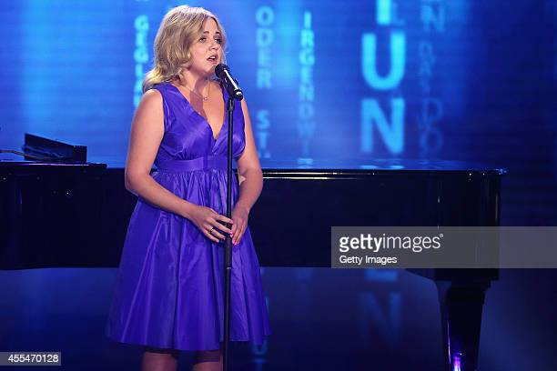 Annett Louisan performs during the 'Udo Juergens Mitten im Leben' TV show on September 1 2014 in Freiburg im Breisgau Germany