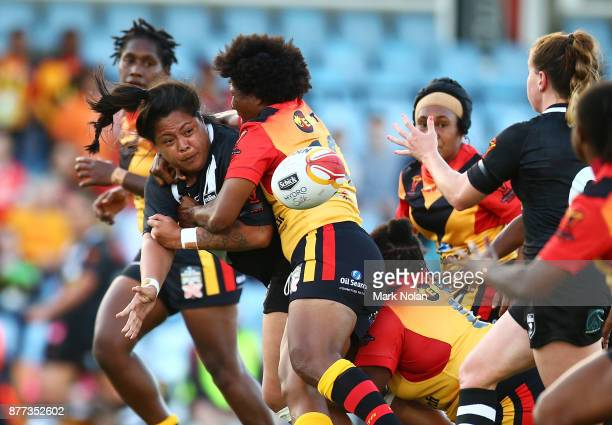Annetta Nuuausala of the Ferns offloads during the Women's Rugby League World Cup match between the Kiwi Ferns and the Papua New Guinea Orchids at...
