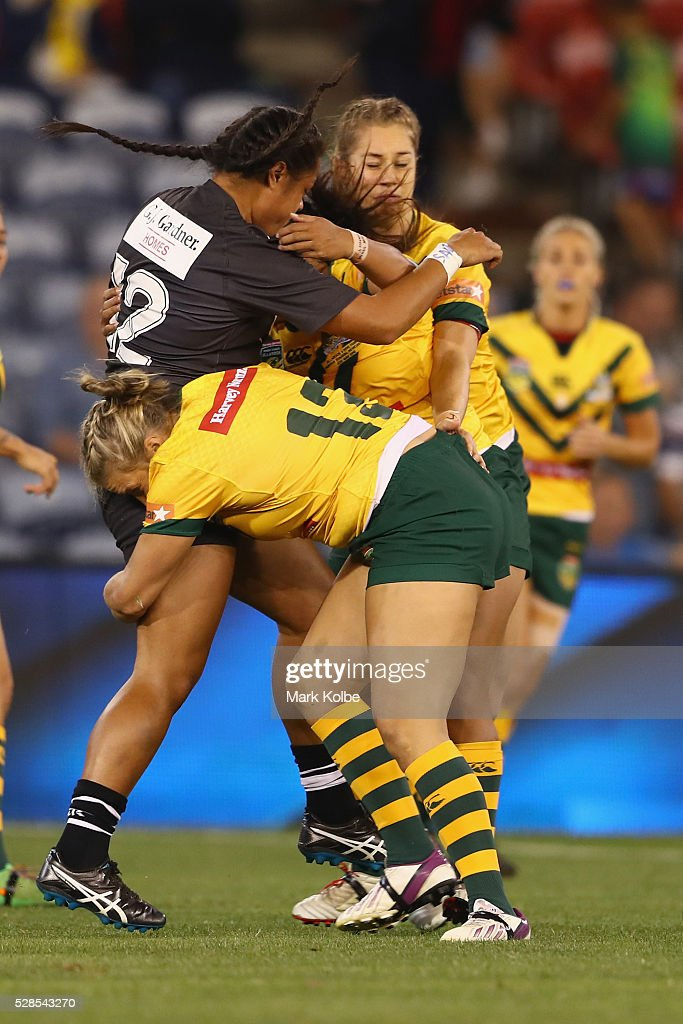 Annetta Nuuausala of the Kiwi Ferns is tackled by Ruan Sims of the Jillaroos during the Women's international Rugby League Test match between the Australian Jillaroos and New Zealand Kiwi Ferns at Hunter Stadium on May 6, 2016 in Newcastle, Australia.