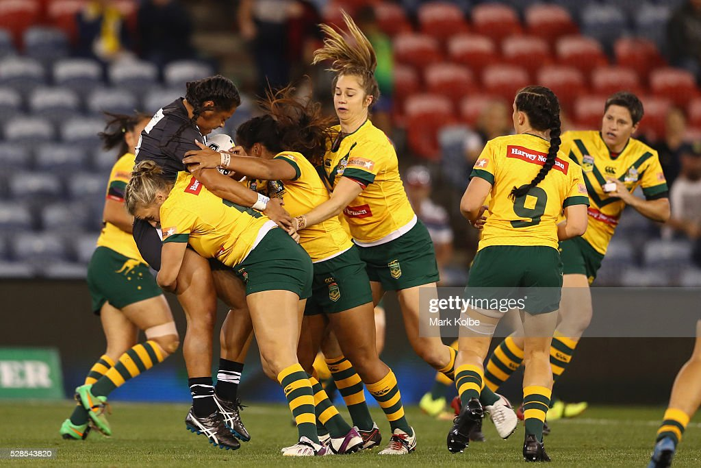 Annetta Nuuausala of the Kiwi Ferns is tackled by the Jillaroos defence during the Women's international Rugby League Test match between the Australian Jillaroos and New Zealand Kiwi Ferns at Hunter Stadium on May 6, 2016 in Newcastle, Australia.