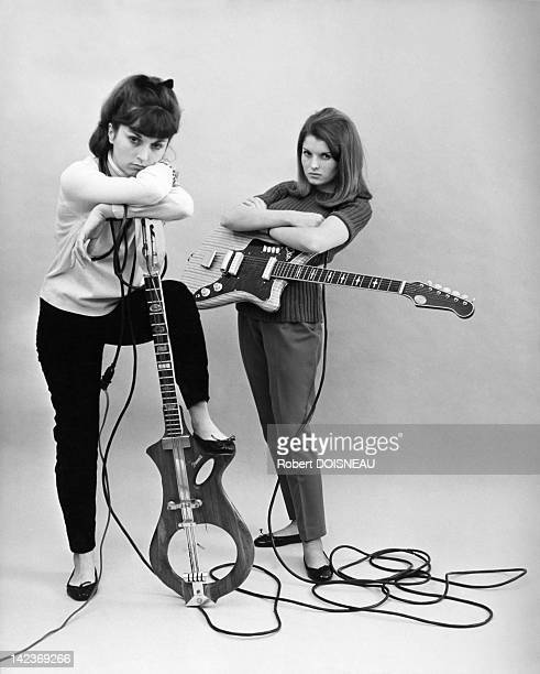 Annette and Francine Doisneau the daughters of Robert Doisneau with guitars for an advertising circa 1960 Paris France