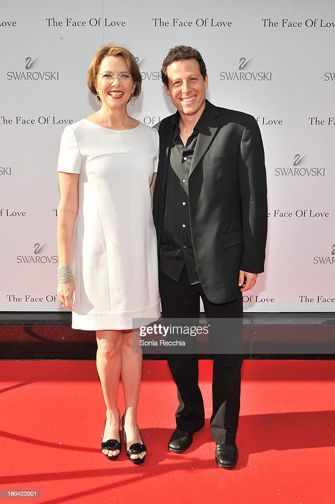 Annette Bening and Arie Posin attend the pre-screening cocktail party presented by Swarovski at Swarovski Flagship Store on September 12, 2013 in Toronto, Canada.