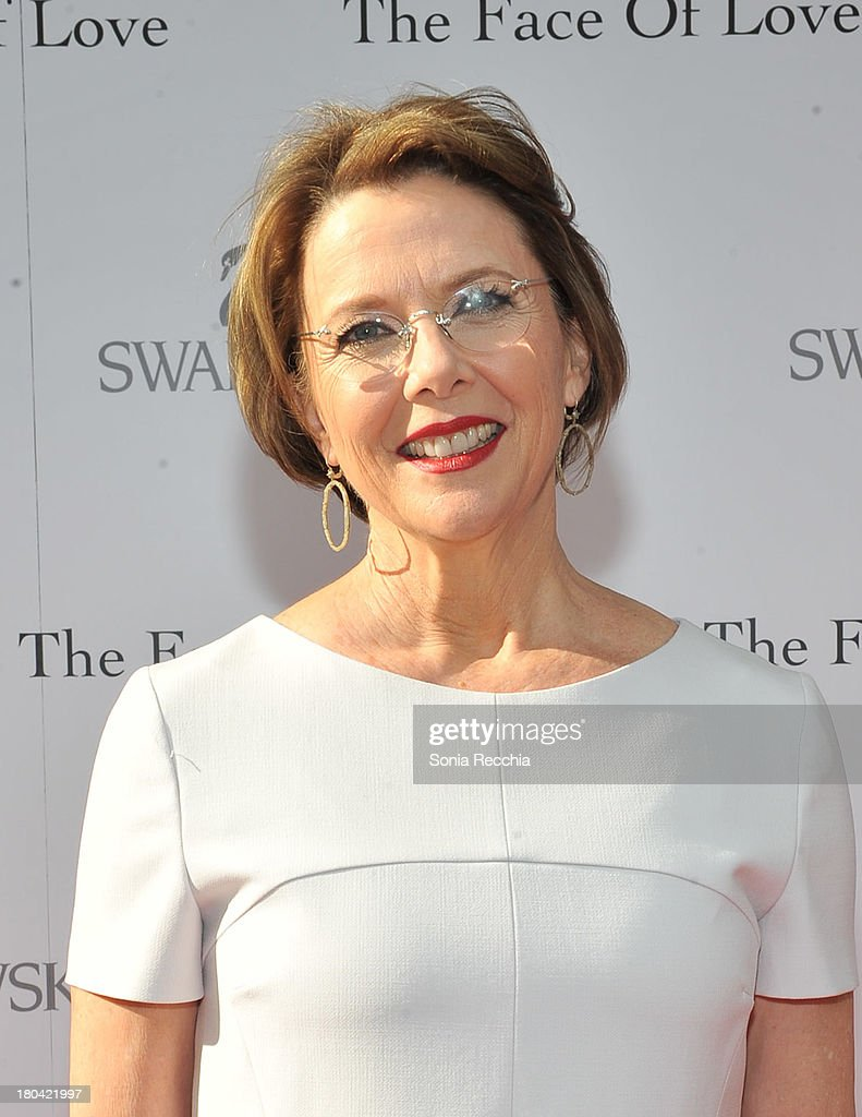 <a gi-track='captionPersonalityLinkClicked' href=/galleries/search?phrase=Annette+Bening&family=editorial&specificpeople=202568 ng-click='$event.stopPropagation()'>Annette Bening</a> attends the pre-screening cocktail party presented by Swarovski at Swarovski Flagship Store on September 12, 2013 in Toronto, Canada.