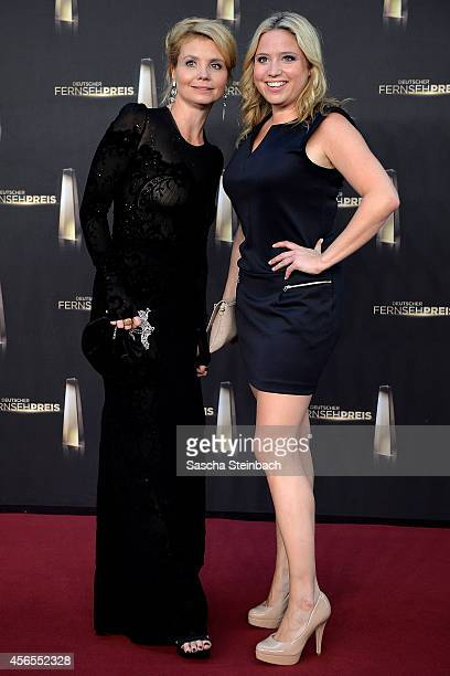 Annette Frier and Caroline Frier arrive at the 'Deutscher Fernsehpreis 2014' at Coloneum on October 2 2014 in Cologne Germany