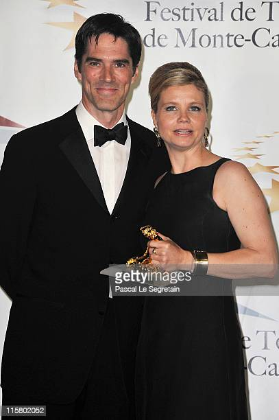 Annette Frier poses with her Golden Nymphe award with Thomas Gibson after the closing ceremony of the 2011 Monte Carlo Television Festival held at...