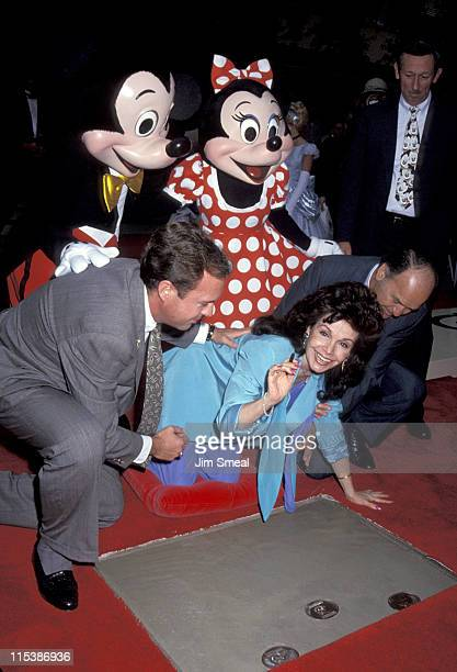 Annette Funicello and husband with Mickey and Minnie Mouse