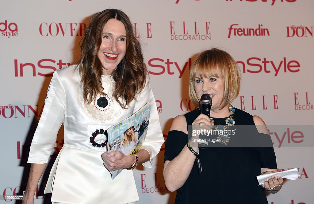 Annette Weber, editor in chief of 'Instyle Streetstyle' (L) and Patrizia Riekel (R) speak to the audience at the Burda Style Group Cocktail on January 17, 2013 in Berlin, Germany.