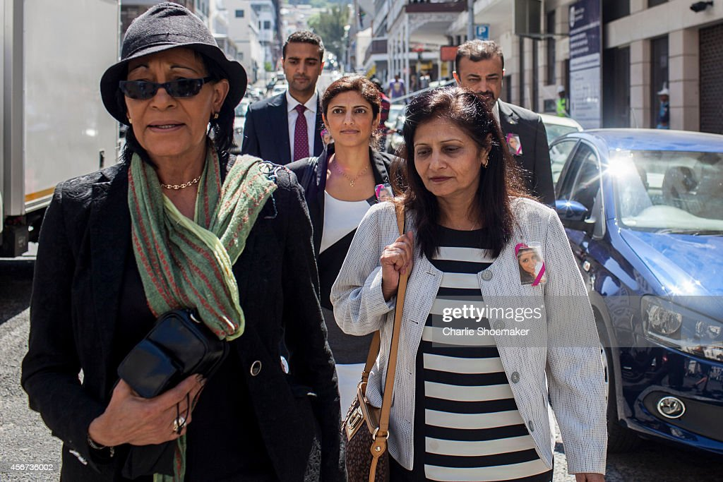 Anni Dewani's family returns to the Western Cape High Court after a lunch break during the first day of trial of Shrien Dewani on October 6, 2014 in Cape Town, South Africa. British businessman Shrien Dewani, who fought an extradition battle for three years, is accused of arranging the murder of his new wife in 2010, just days after their marriage. A South African taxi driver and two accomplices are serving prison sentences for their connection with the murder of Mrs Dewani.