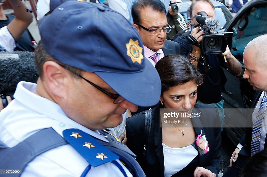 Anni Dewani's father Mr Vinod Hindocha ( L) and sister Ami Denborg arrive at the Western Cape High Court for the start of the trial of Shrien Dewani, on October 6, 2014 in Cape Town, South Africa. The British businessman, who fought an extradition battle for three years, is accused of arranging the murder of his new wife in 2010, just days after their marriage. A South African taxi driver and two accomplices are serving prison sentences for their connection with the murder of Mrs Dewani.
