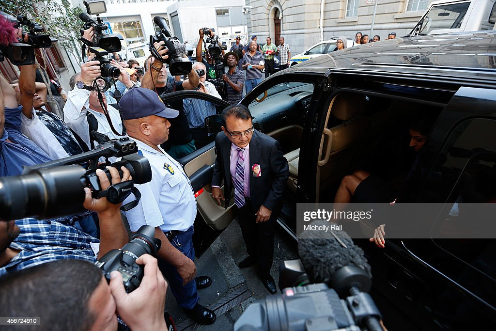Anni Dewani's father Mr Vinod Hindocha arrives at the Western Cape High Court for the start of the trial of Shrien Dewani, on October 6, 2014 in Cape Town, South Africa. The British businessman, who fought an extradition battle for three years, is accused of arranging the murder of his new wife in 2010, just days after their marriage. A South African taxi driver and two accomplices are serving prison sentences for their connection with the murder of Mrs Dewani.