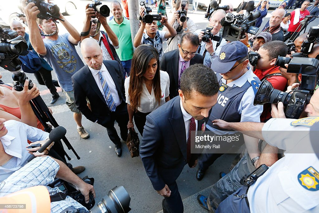 Anni Dewani's father Mr Vinod Hindocha (C), cousin Sneha Hindocha (L) and brother Anish Hindocha (R) arrive at the Western Cape High Court for the start of the trial of Shrien Dewani, on October 6, 2014 in Cape Town, South Africa. The British businessman, who fought an extradition battle for three years, is accused of arranging the murder of his new wife in 2010, just days after their marriage. A South African taxi driver and two accomplices are serving prison sentences for their connection with the murder of Mrs Dewani.