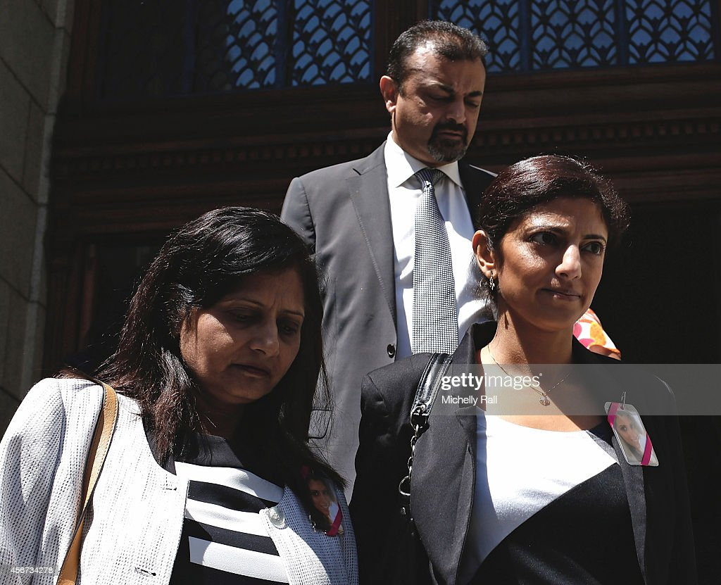 Anni Dewani's sister, Ami Denborg, flanked by Anni's parents Nilam and Vinod Hindocha, walks outside the Western Cape High Court during the start of the trial of Shrien Dewani, on October 6, 2014 in Cape Town, South Africa. The British businessman, who fought an extradition battle for three years, is accused of arranging the murder of his new wife in 2010, just days after their marriage. A South African taxi driver and two accomplices are serving prison sentences for their connection with the murder of Mrs Dewani.