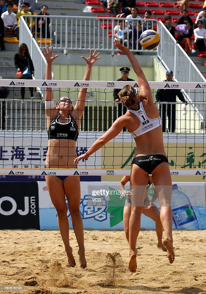 Anni Schumacher (L) of Germany defends against Jantine van der Vlist (R) of The Netherlands during the women's qualification of FIVB Beach Volleyball Shanghai Grand Slam at Jinshan City Beach on May 1, 2013 in Shanghai, China.