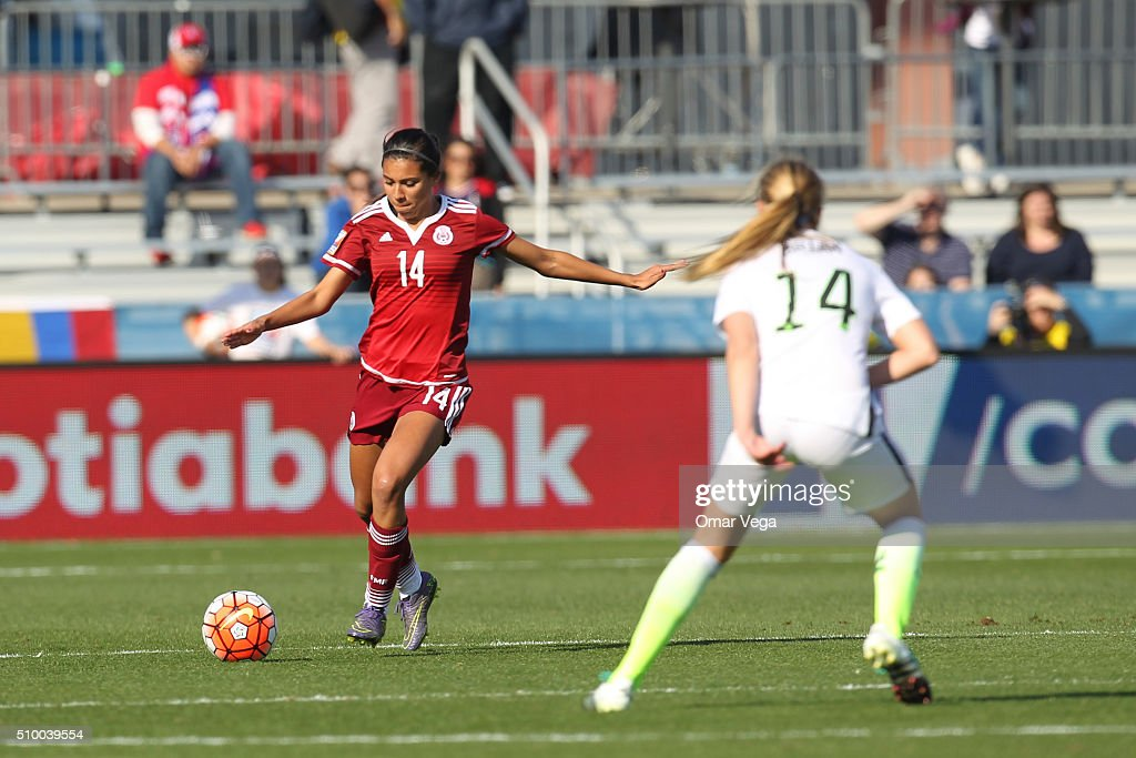 Annia Mejia of Mexico vies for the ball with <a gi-track='captionPersonalityLinkClicked' href=/galleries/search?phrase=Morgan+Brian&family=editorial&specificpeople=7948656 ng-click='$event.stopPropagation()'>Morgan Brian</a> of USA during a match between Mexico and USA as part of the Women's Olympic Qualifiers at Toyota Stadium on February 13, 2016 in Dallas, United States.