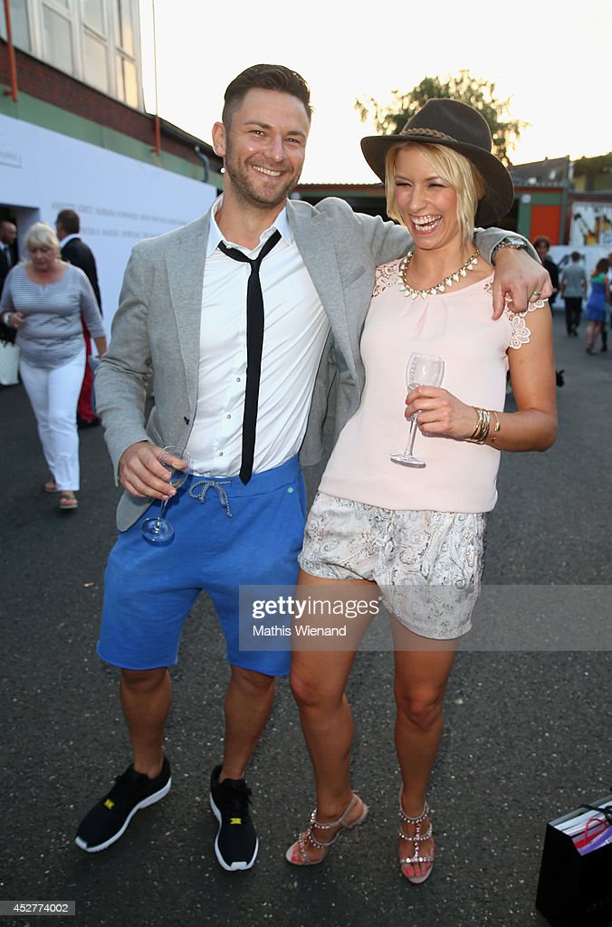 Annica Hansen and her boyfriend Marcel attend the Van Laack Show at Platform Fashion on July 26, 2014 in Duesseldorf, Germany.