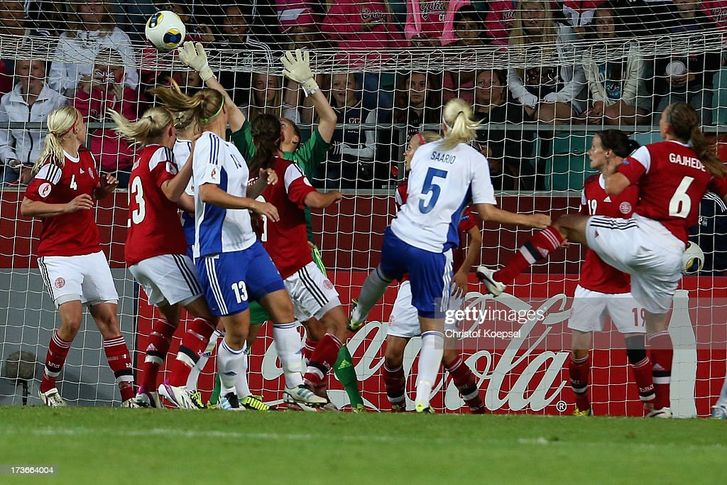 Annica Sjoelund of Finland (3rd L) scores the first goal during the UEFA Women's EURO 2013 Group A match between Denmark and Finland at Gamla Ullevi Stadium on July 16, 2013 in Gothenburg, Sweden.