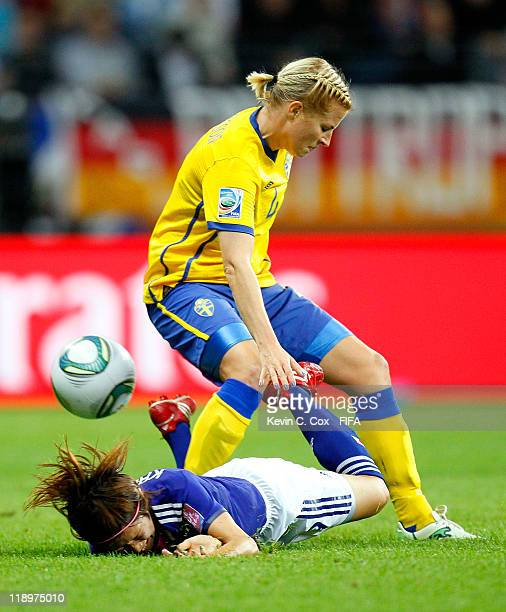 Annica Svensson of Sweden tackles Nahomi Kawasumi of Japan during the FIFA Women's World Cup Semi Final match between Japan and Sweden at the FIFA...