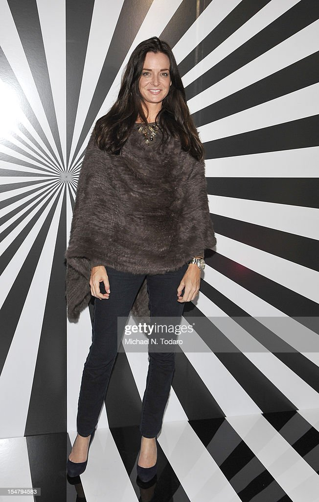 <a gi-track='captionPersonalityLinkClicked' href=/galleries/search?phrase=Annie+Churchill&family=editorial&specificpeople=667988 ng-click='$event.stopPropagation()'>Annie Churchill</a> attends the celebration of the collaboration between Jimmy Choo and Artist Rob Pruitt at The Fletcher Sinclair Mansion on October 25, 2012 in New York City.