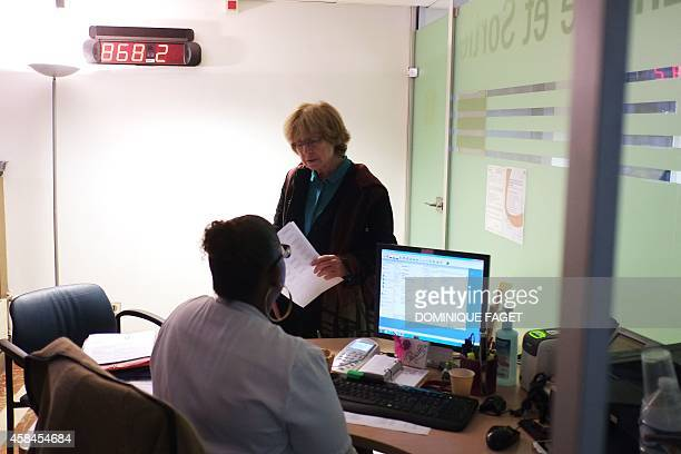 Annie Claude Gomont a woman suffering from breast cancer registers for admission to the oneday surgery department of the French hospital institut...