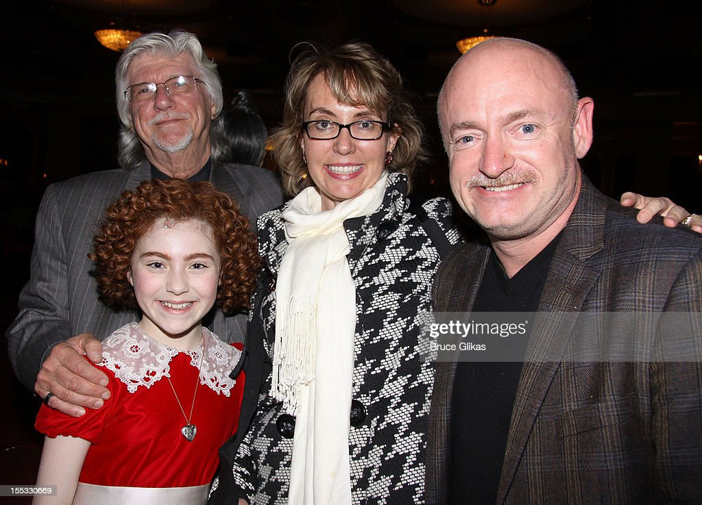 Annie composer Martin Charnin, Lilla Crawford as 'Annie', Gabrielle Giffords and husband Mark E. Kelly pose backstage at the hit revival of 'Annie' on Broadway at The Palace Theater on November 2, 2012 in New York City.