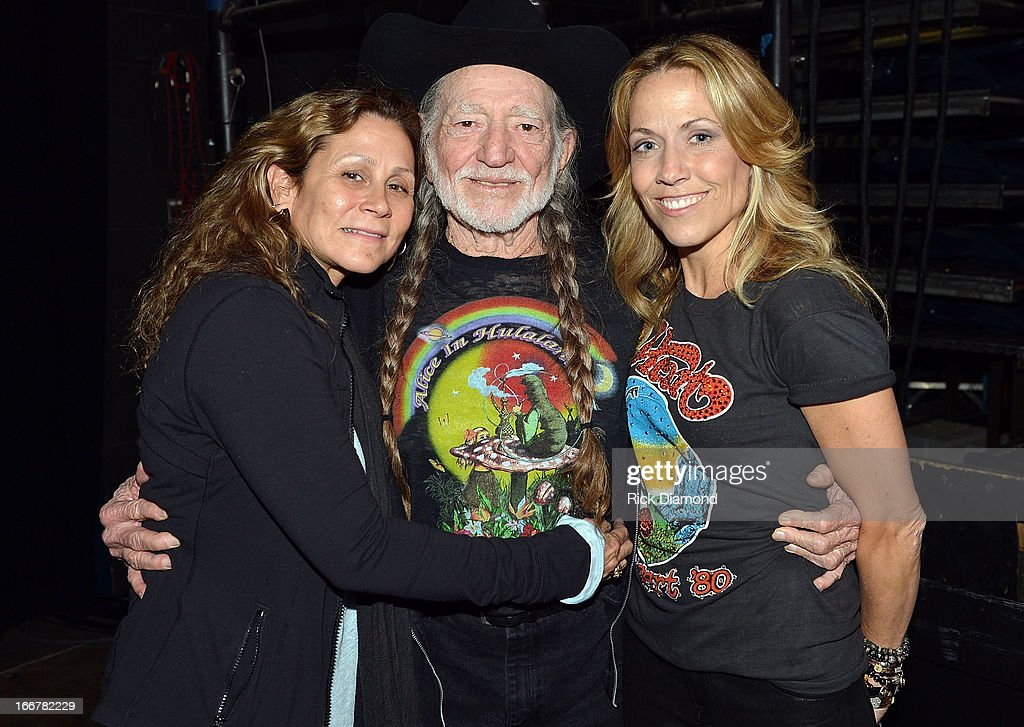 Annie D'Angelo, Willie Nelson, and Sheryl Crow backstage during Keith Urban's Fourth annual We're All For The Hall benefit concert at Bridgestone Arena on April 16, 2013 in Nashville, Tennessee.