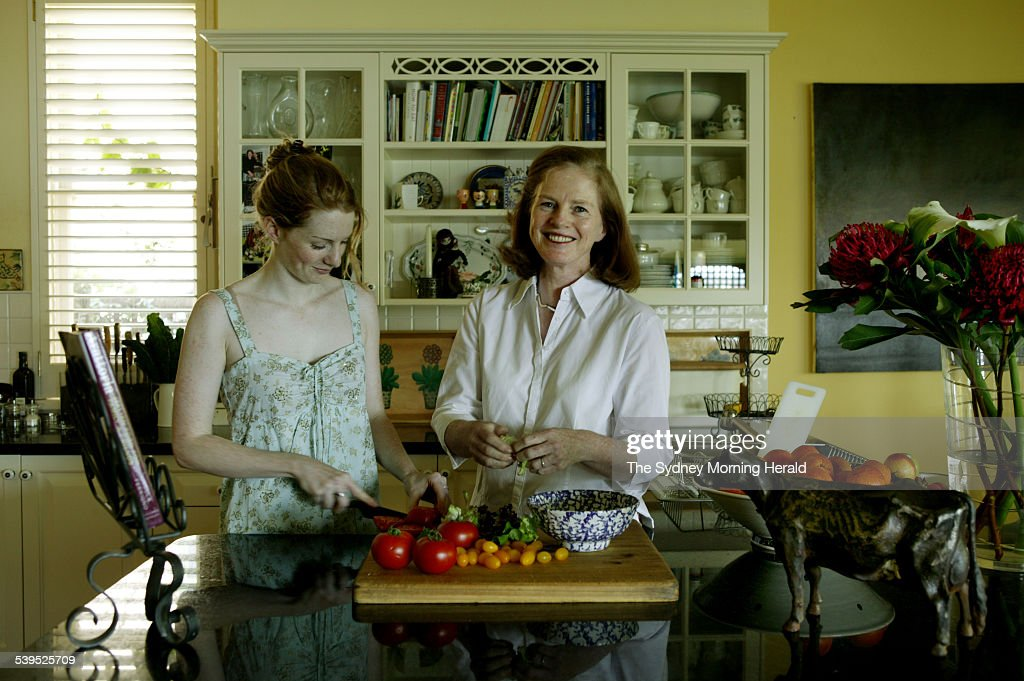 October 2004 From Kitchen Annie Fesq and her daughter, Harriet, preparing a salad in the kitchen of her
