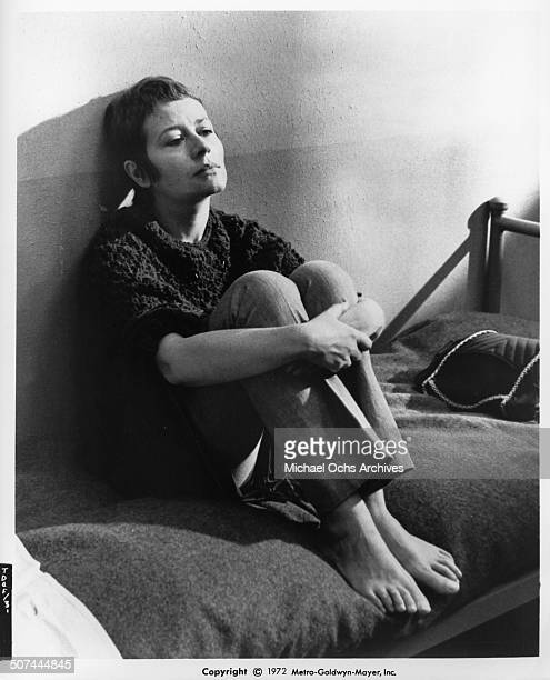 Annie Girardot sits in jail in a scene from the MGM movie 'To Die of Love' aka 'Mourir d'aimer' Circa 1972