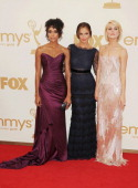 Annie Ilonzeh Minka Kelly and Rachael Taylor arrive at the 63rd Primetime Emmy Awards at the Nokia Theatre LA Live on September 18 2011 in Los...