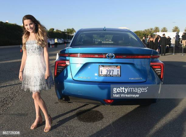 Annie LeBlanc poses with the Toyora Mirai the zero emissions car during the 2017 EMA Awards Presented by Toyota on September 23 2017 in Santa Monica...