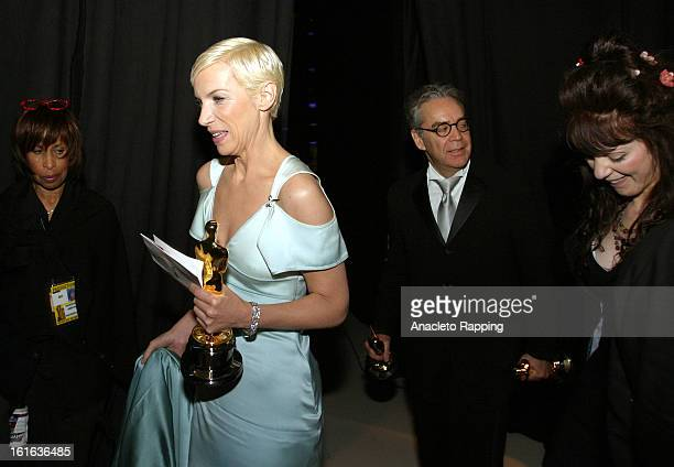 Annie Lennox and Howard Shore and Fran Walsh are photographed at the 76th Annual Academy Awards after winning the Oscar for Best Song in 'Lord of the...