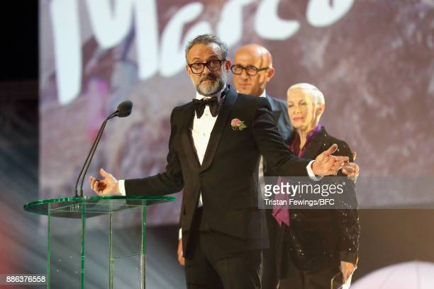 Annie Lennox and Massimo Bottura present Marco Bizzarri for Gucci with the award for Business Leader on stage during The Fashion Awards 2017 in...